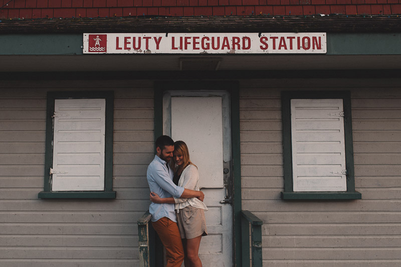 Couple in front of leuty lifeguard station in toronto ontario