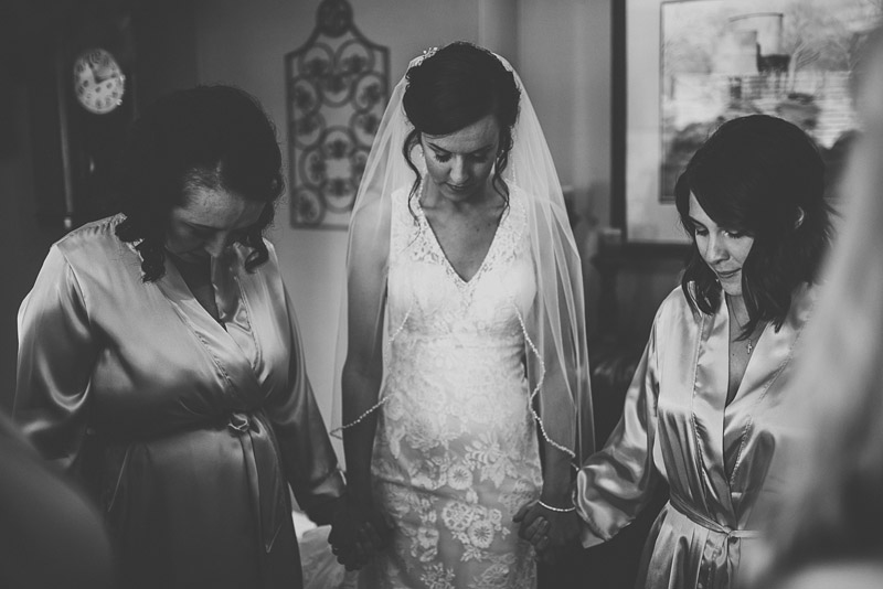 bridal party praying together