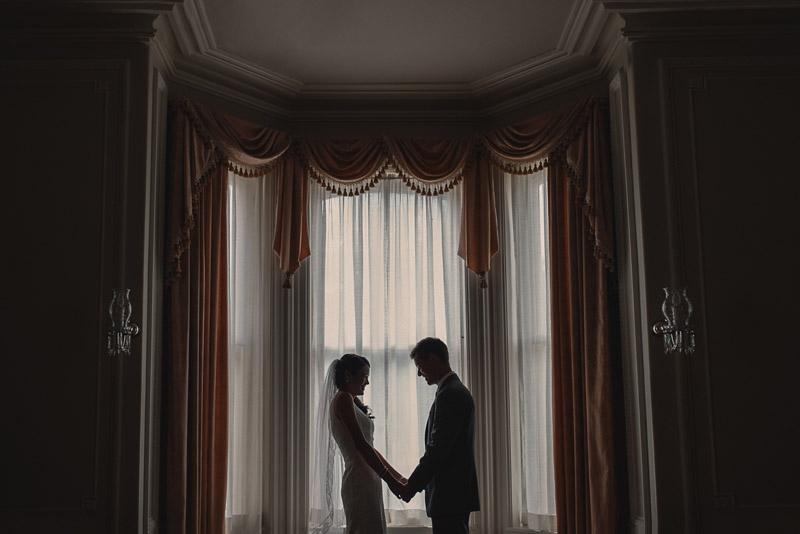first look between bride and groom in a victorian house