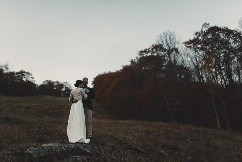 couple embracing on the mountainside during their private elopement