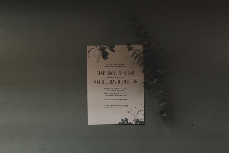 Wedding invitation and foliage