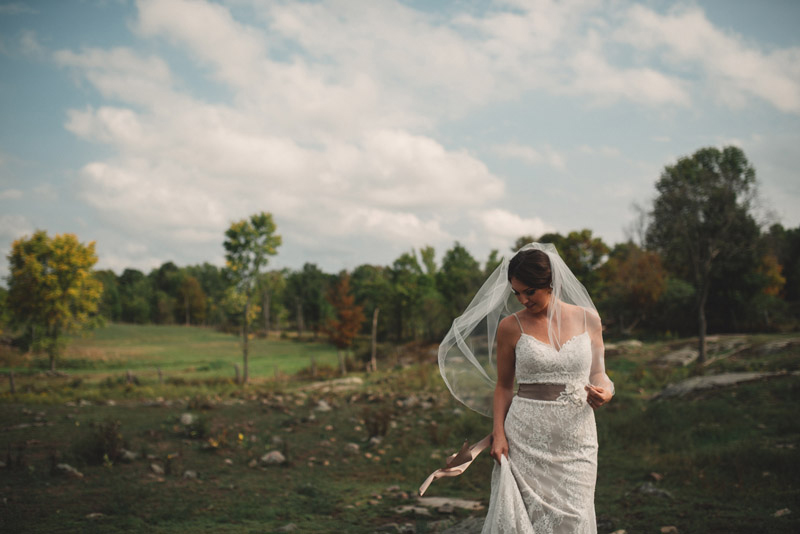 bridal portrait in rocky field