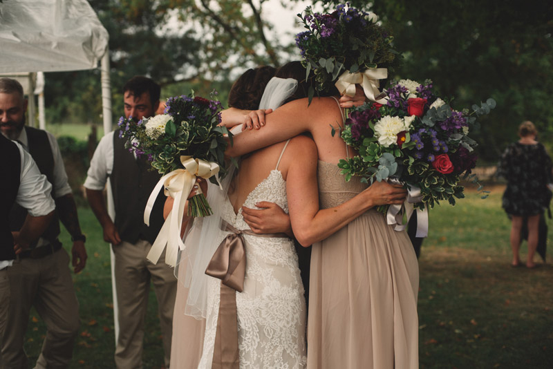 sisters hugging after wedding photography