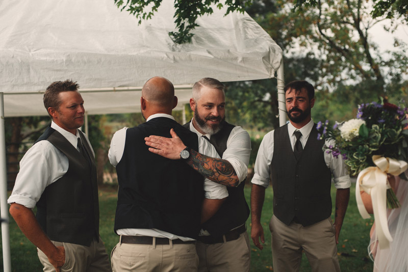 groomsmen hugging after wedding ceremony