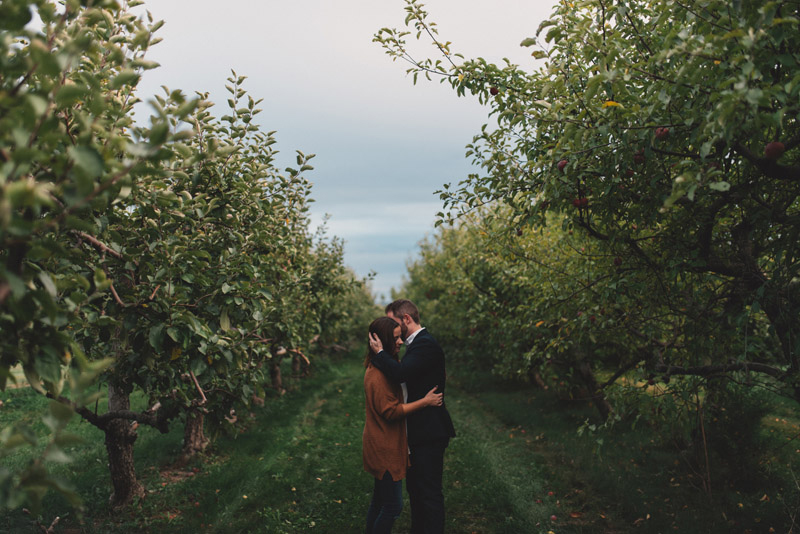 couple embracing in vineyard row
