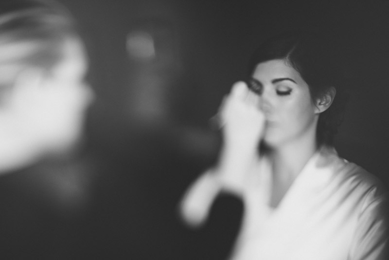 free-lensing photo of bride's make-up being done