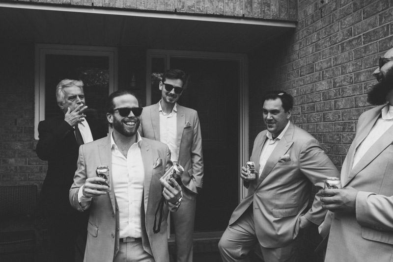 groom double fisting beers
