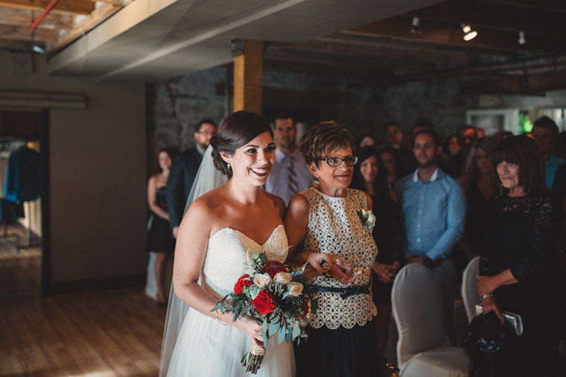 bride walking down aisle with her mom