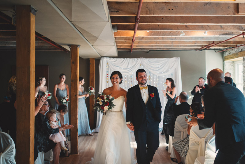 couple happily walking down aisle after wedding ceremony