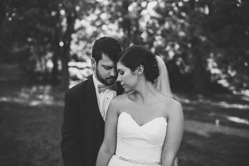 portrait of newly wed couple in park