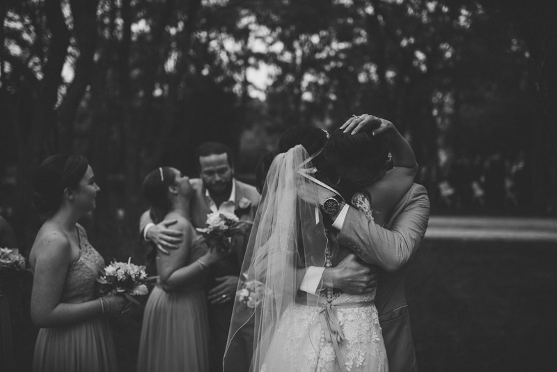 bride embracing brother