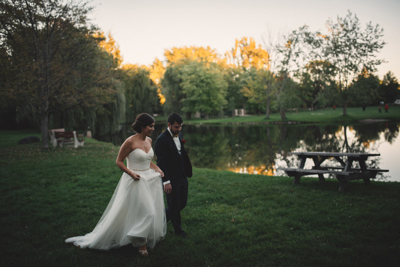 walking through a park as newly weds