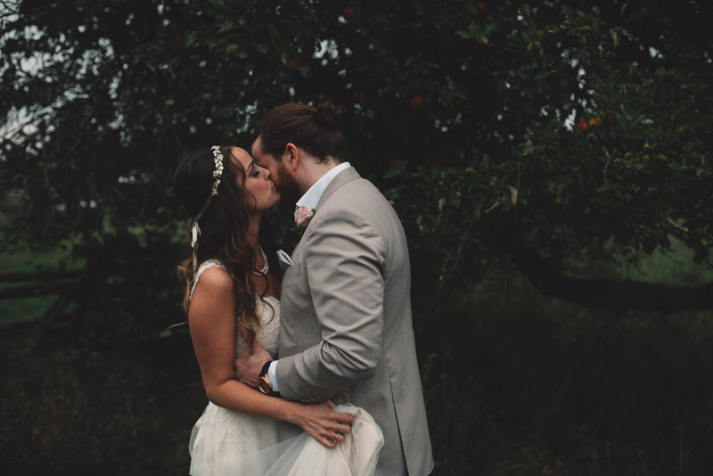 bride kissing grooms cheek