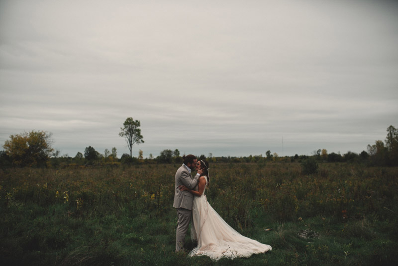 couple kissing in open field