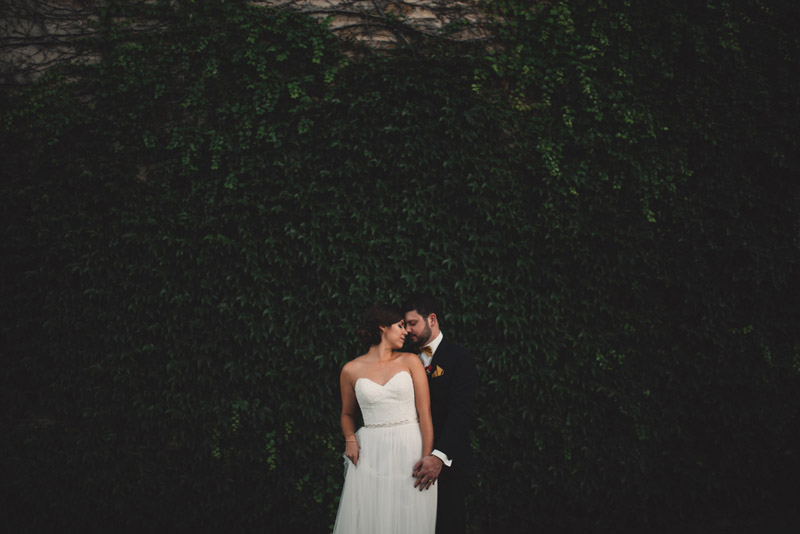 trendy image of couple in front of beautiful ivy wall