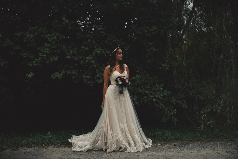 Bride in front of foliage